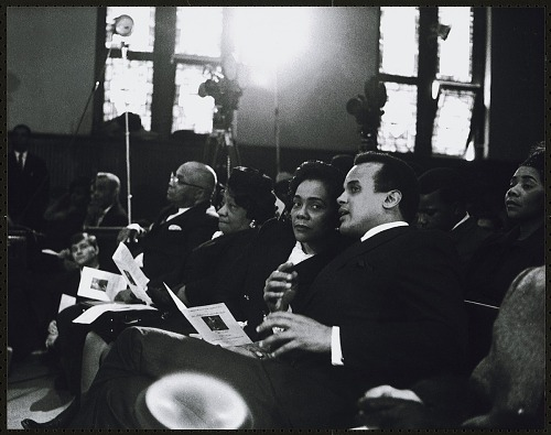 Image for Harry Belafonte confers with Mrs. Coretta Scott King while seated next to Rev. Martin Luther King Sr. and Mrs Alberta King