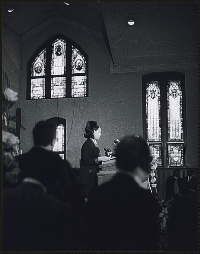 Image for An invited speaker addresses the audience inside Ebenezer Baptist Church at the first birthday celebration of Dr. King in 1969