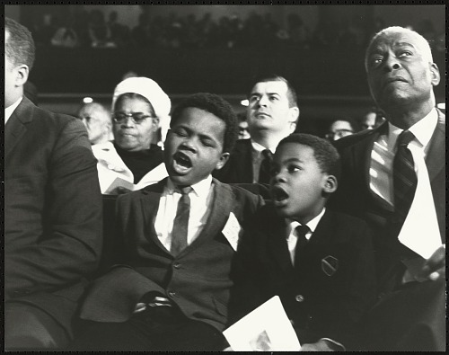 Image for Dr. Benjamin Elijah Mays, president of Morehouse College, seated with a young Isaac Farris Jr. and friend