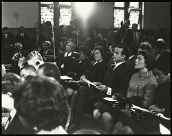 Coretta Scott King observes the program from her seat with actor Harry Belafonte and members of her family