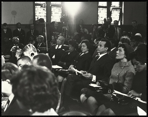 Image for Coretta Scott King observes the program from her seat with actor Harry Belafonte and members of her family