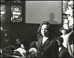 A somber Mrs. Coretta Scott King entering into Ebenezer Baptist Church
