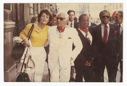 Image for Photograph of James Baldwin standing with David Baldwin and Leonard Bernstein