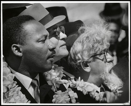 Image for Martin Luther King, Jr. with flower lei and leading rabbis Maurice Eisendrath and Abraham Heschel