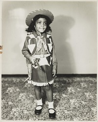 Studio portrait of a young girl in a cowgirl costume