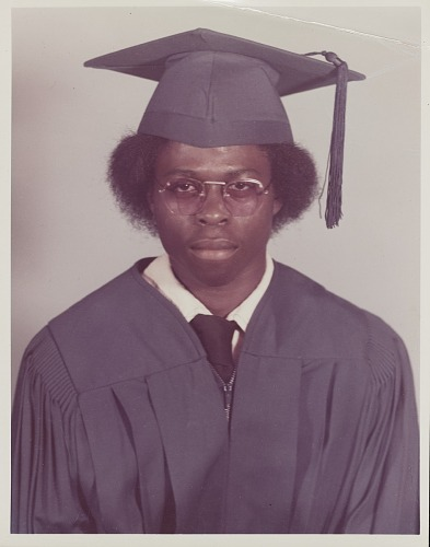 Image for Studio portrait of a young man in graduation cap and gown