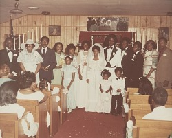 Wedding portrait of bride and groom with family