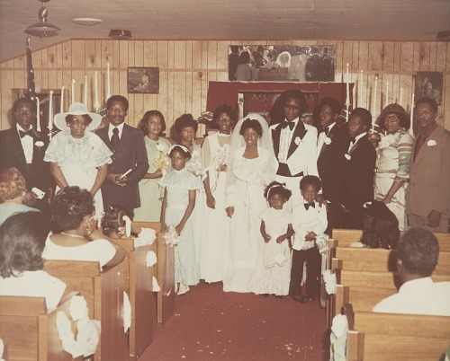 Image for Wedding portrait of bride and groom with family