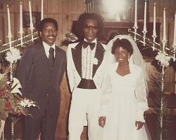 Wedding portrait of the bride and groom with another man