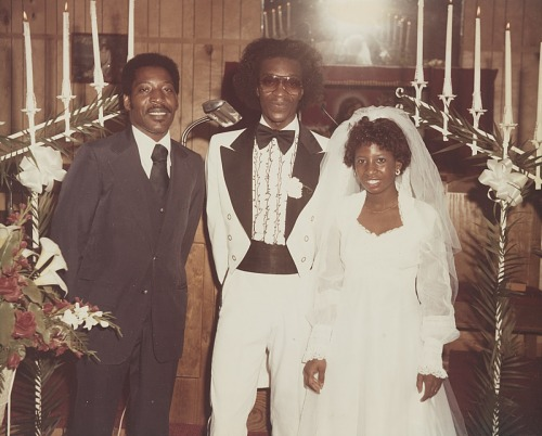 Image for Wedding portrait of the bride and groom with another man