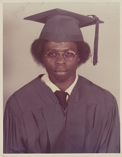 Image for Studio portrait of a man in graduation cap and gown