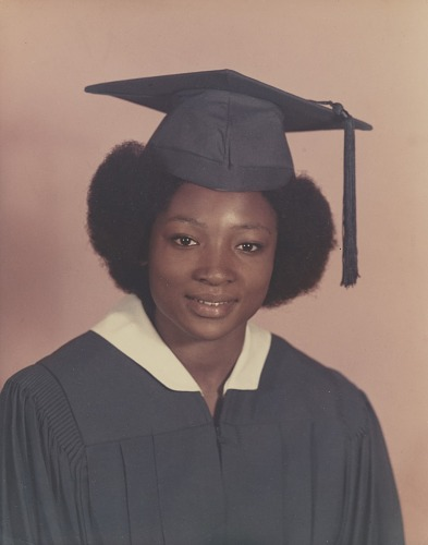 Image for Studio portrait of a woman in graduation cap and gown