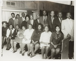 Group portrait of men and women in church pews