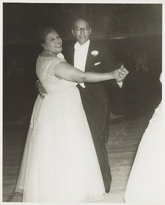 Indoor portrait of J.H. White and Augusta White dancing