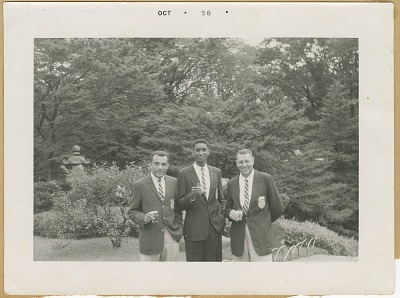 Photograph of three members of the U.S. AAU Track and Field Team in Tokyo, Japan