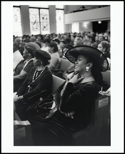 Image for Mrs. Lisha Morris, the First Lady of the Lane Tabernacle CME Church, enjoys a laugh during morning services, St. Louis, Missouri, 2005