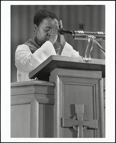 Image for Dr. Jacquelyn Grant prays that her words might be blessed before delivering the morning sermon on annual Women's Day at Allen Temple Baptist Church, Oakland, California, 1998