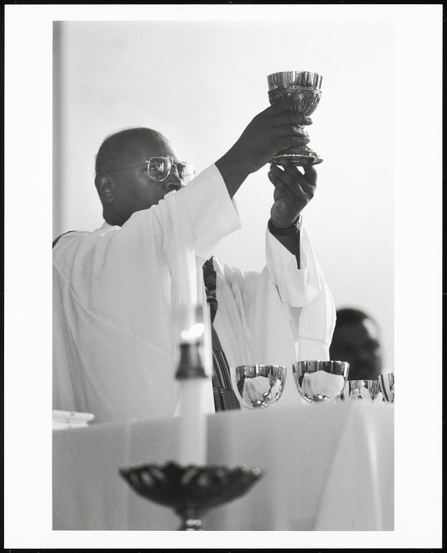 Image for Father Victor Cohea blesses the sacrament during the Holy Eucharist at St. Francis de Sales Catholic Church, New Orleans, Louisiana, 2005