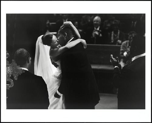Image for An exuberant bride, Tiffany Ellis, is united in matrimony to Calvin O Butts IV, in the historic Abyssinian Baptist Church , officiated by its pastor (Calvin's father), the Rev. Dr. Calvin O Butts III, Harlem, New York, 2004