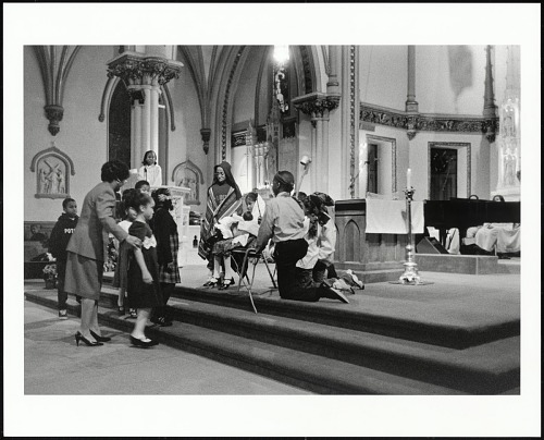 Image for Young children reenact the birth of Jesus in the Christmas Nativity play at St. Augustine Roman Catholic Church, Washington, D.C. 2003