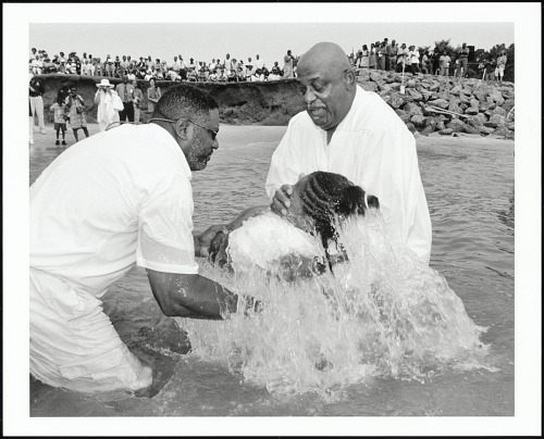 Image for A more than 40 year old tradition of baptizing in the Chesapeake Bay at Taylor's Beach is continued every 3rd Sunday in August by Rev. T. Wright Morris (right), pastor of Shiloh Baptist Church, Reedville, Virginia, 2003