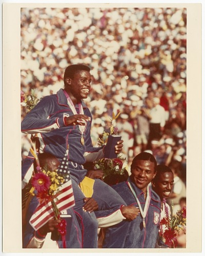 Image for Photograph of Carl Lewis with his fourth gold medal at the Los Angeles Olympics