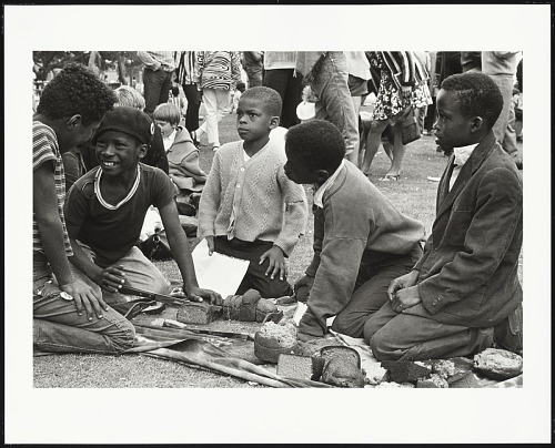 Image for Children cutting bread which was brought to the Free Huey Rally by the Diggers, De Fremery Park, Oakland, CA, No. 35
