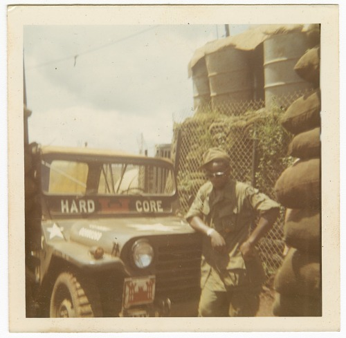 Image for Photograph of an American soldier leaning on a jeep in Vietnam