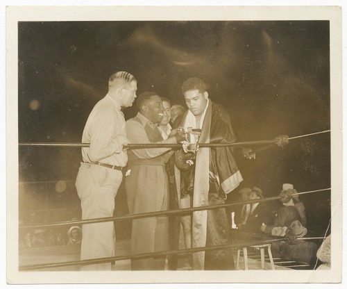 Image for Gelatin silver print of Joe Louis accepting a championship belt
