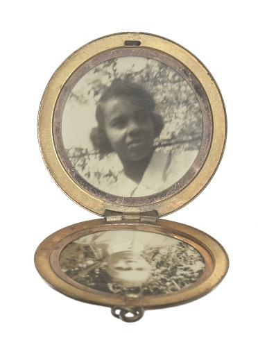 Image for Locket with photographs of Harriette and Harry T. Moore
