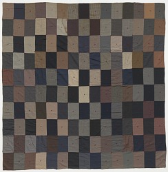 Quilt made from gray, black, brown, blue, and red suiting samples