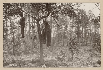Photograph of the lynched bodies of four men