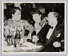 Thumbnail for Photograph of a man and two women seated at a table