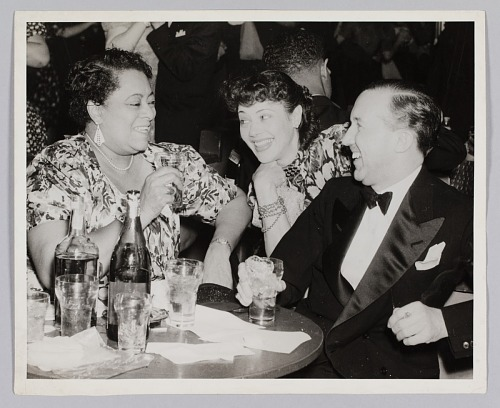 Image for Photograph of a man and two women seated at a table