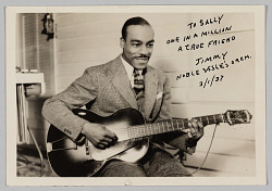 Photograph of Jimmy Miller playing guitar