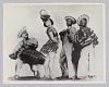 Thumbnail for Composite photograph of three men and a woman dressed in theatrical costumes