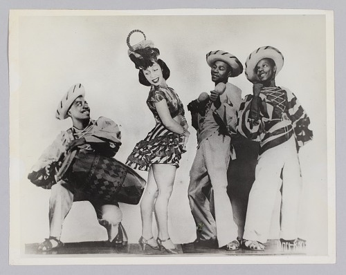 Image for Composite photograph of three men and a woman dressed in theatrical costumes