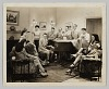 thumbnail for Image 1 - Photograph of a group of people gathered around a piano