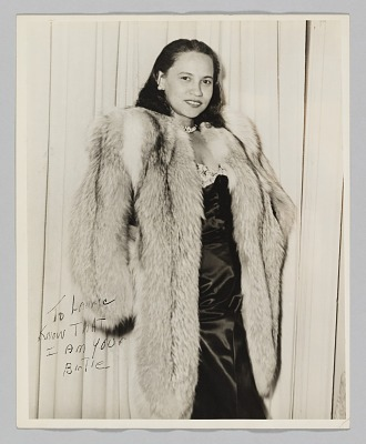 Photograph of a woman, Birtie, in a fur coat