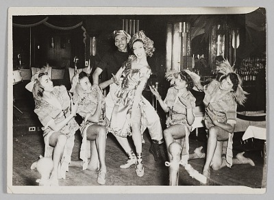Photograph of five female performers and one male performer
