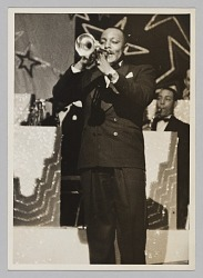 Photograph of a man playing the trumpet