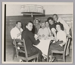 Photograph of a group of people playing cards