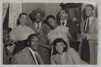 Photograph of Laura Cathrell and a group of men and women at a party