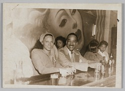 Photograph of a man and a woman seated at a bar