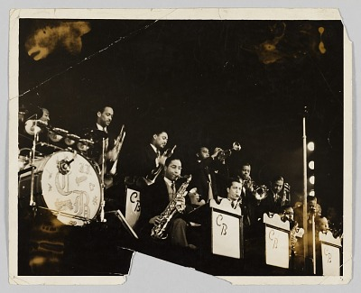 Photograph of a big band performing on stage