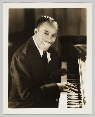 Photograph of a piano player