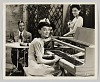 thumbnail for Image 1 - Photograph of a woman playing piano