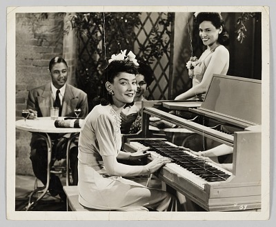 Photograph of a woman playing piano