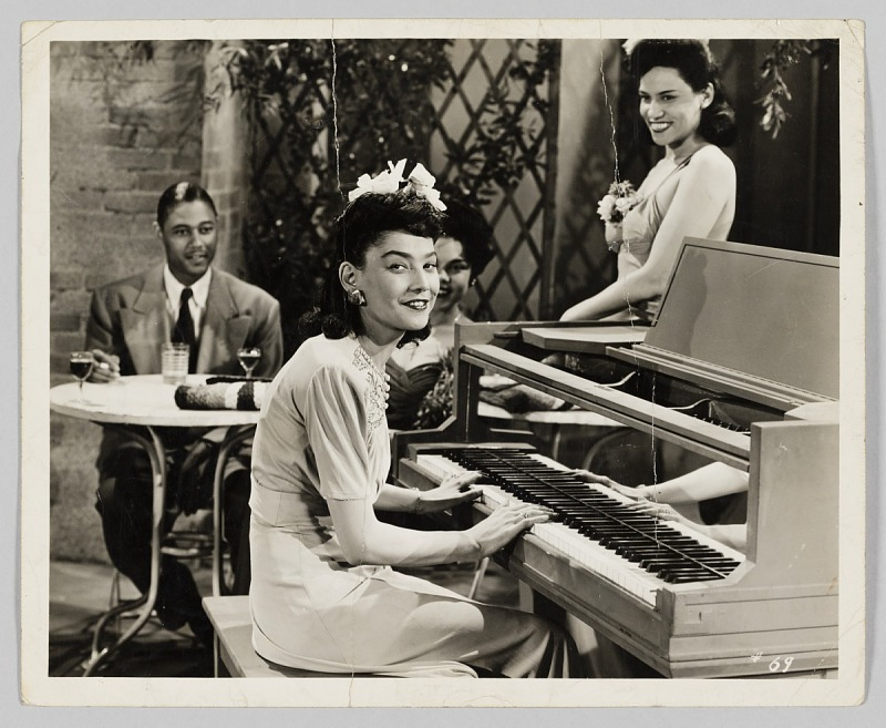 Image 1 for Photograph of a woman playing piano