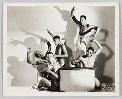 Photograph of five male performers with drums